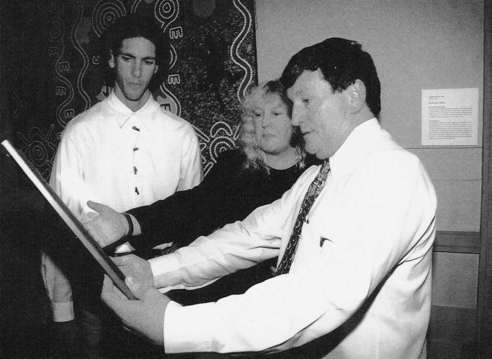 Shauna McGilvray and Cr Jim Soorley admiring Jared's painting on December 7, 1999, Brisbane City Hall.